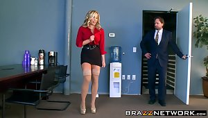 Hot busty secretary satisfies her horn-mad boss in an office