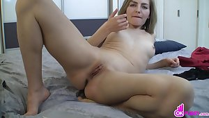 Kinky blonde with short hair shows her shaved pussy and plays with it