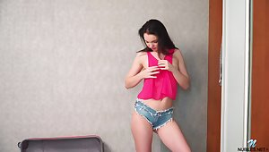 Uninhibited teen in jeans shorts Kaliy gets naked coupled to plays to snatch